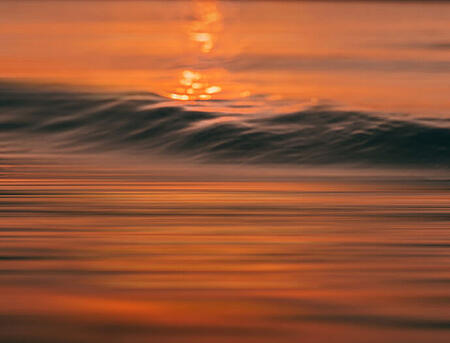 Sunset reflecting on waves in the sea