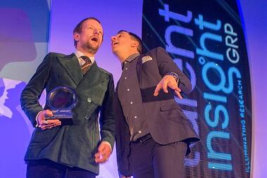 Talent MD David Steel collecting award from comedian Russell Kane